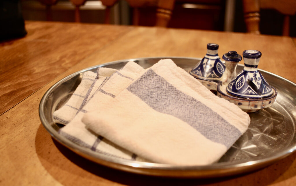 cloth napkins on a tray to save money